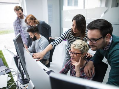 Software developers solving a problem - stock photo