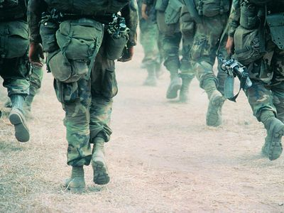 Soldiers marching in desert