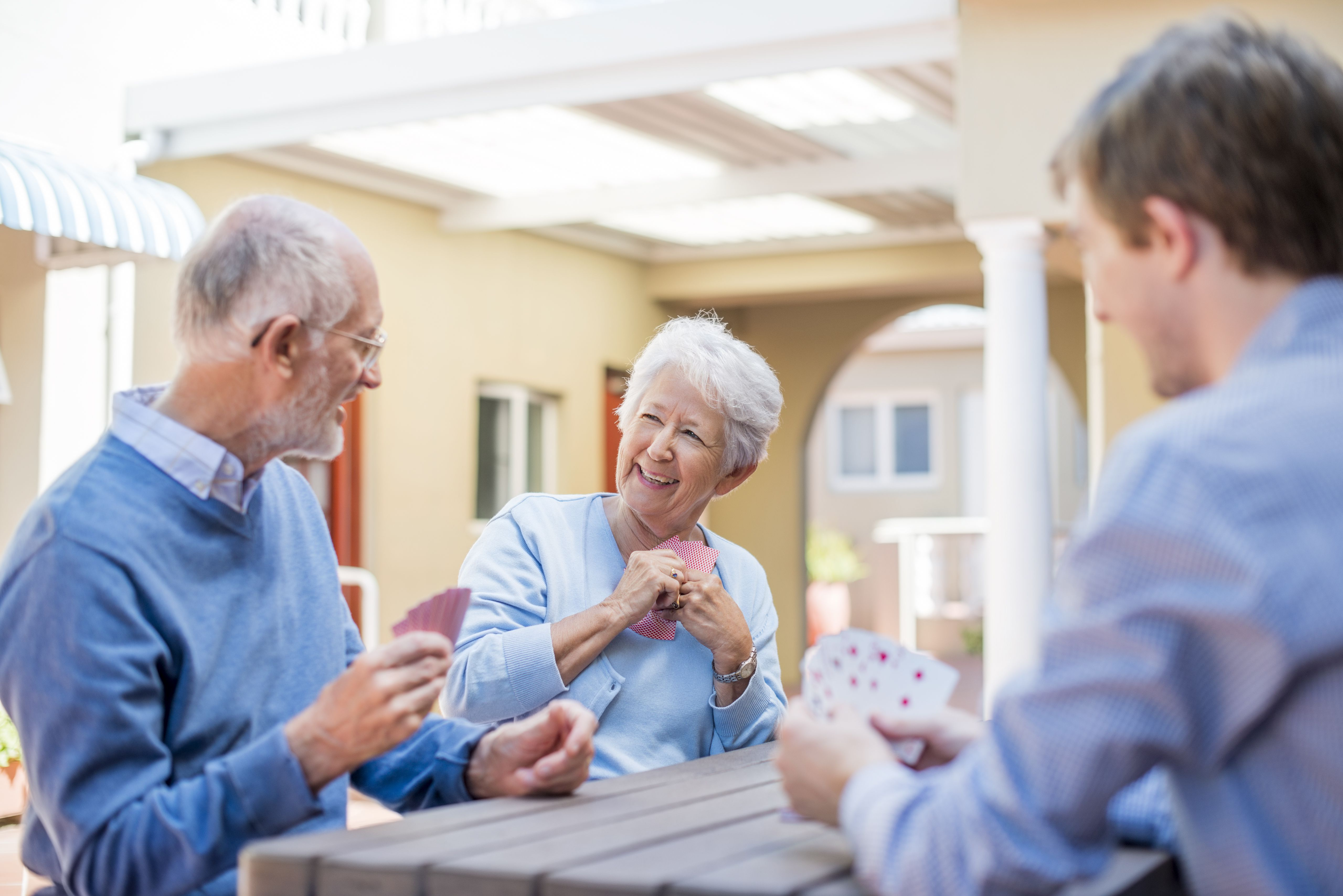 Couple in retirement community with caregiver