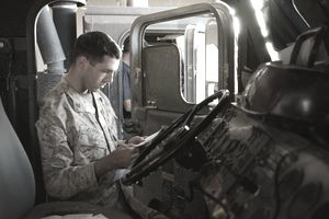 Soldier reading military mail