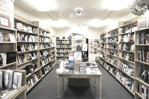 Books on shelves and table in bookstore