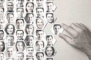 Grid of hexagonal portraits with a hand adding new one, representing social media background checks.