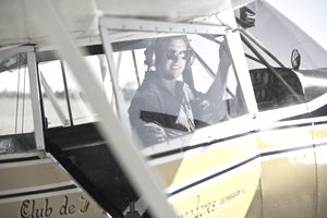 Young pilot in a propeller-driven plane