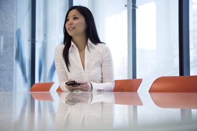 77b5655f489 Business woman sitting at conference table