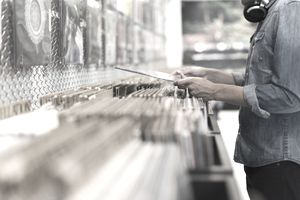 Man browsing through vinyl albums in a record store