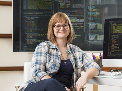 Woman in front of computers