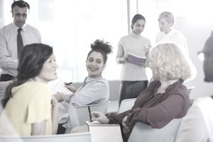 Employees having conversations in groups