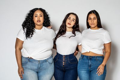 Plus size women in casuals on white background
