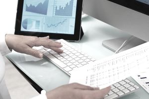 a business person working on finance reports