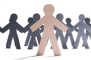 Group of paper person cut-outs with one in front as a leader