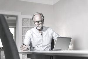 Portrait of man using a computer at home