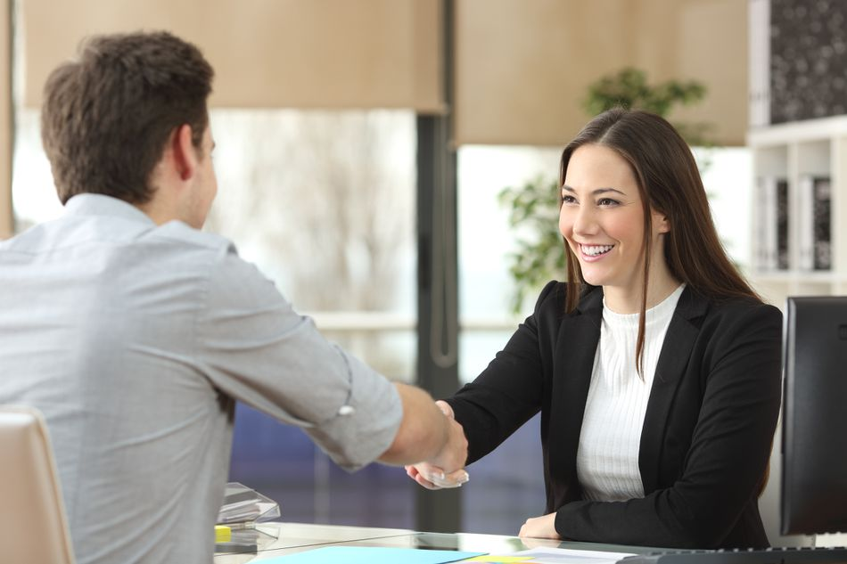 Businesswoman handshaking with client closing deal