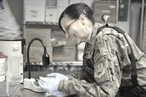 U.S. Air Force Lt. Col. Miriam Montes, a flight commander, cross-matches blood to determine its type and compatibility in the lab