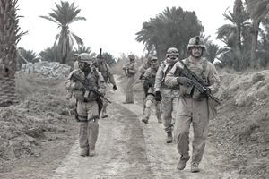 Marines from the 24th Marine Expeditionary Unit's Reconnaissance and Surveillance Platoon search for weapons and munitions outside of a house in Jabella, Iraq, Jan 19. Six CH-46E Sea Knight helicopters ferrying a joint strike force -- composed of elements of the Iraqi SWAT team, the 24th MEU's Force Reconnaissance platoon and U.S. Army troops -- swarmed the target, a crop of houses believed to shelter a number of militants and a stockpile of weapons and munitions. The raid kicked off Operation Checkmate, a fresh offensive aimed at disrupting insurgent activity ahead of national elections later this month.