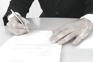Man signing typed letter