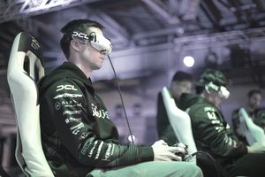 a young man wearing VR goggles and playing a video gam
