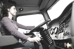 Young woman driving her truck