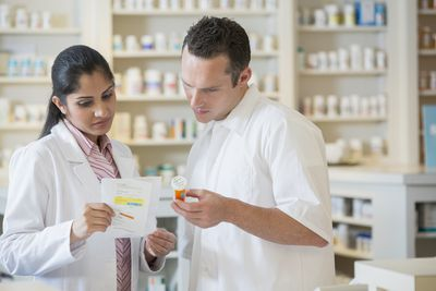 pharmacist and pharmacy technician looking at medication