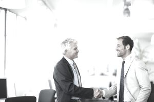 B2B salesman shaking hands with a customer.