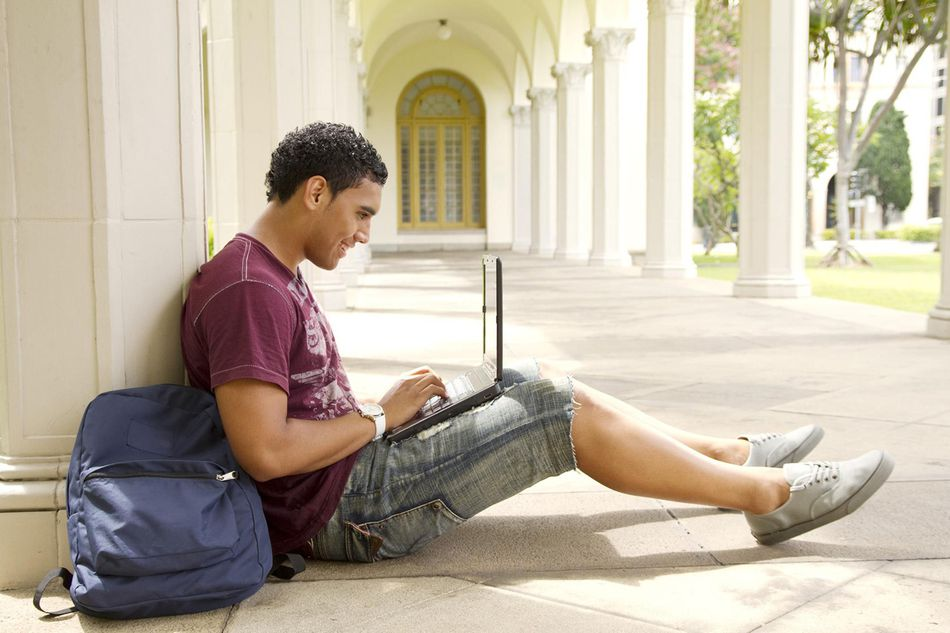 Male College Student on Notebook