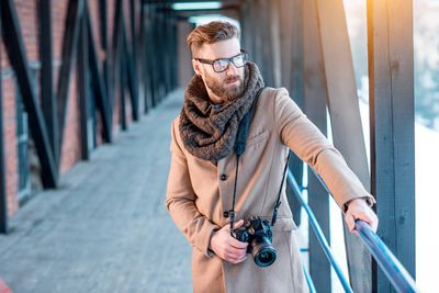 Handsome man in winter elegant clothes outdoors