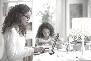 Woman working from home with child remote work