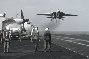 Navy plane taking off of carrier