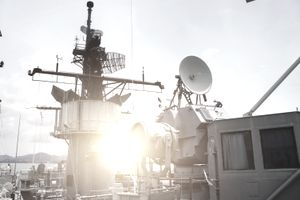 Antenna and satellite dish on a battleship.