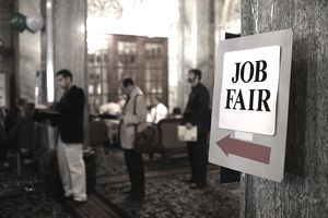 Job Fair sign and people standing in line