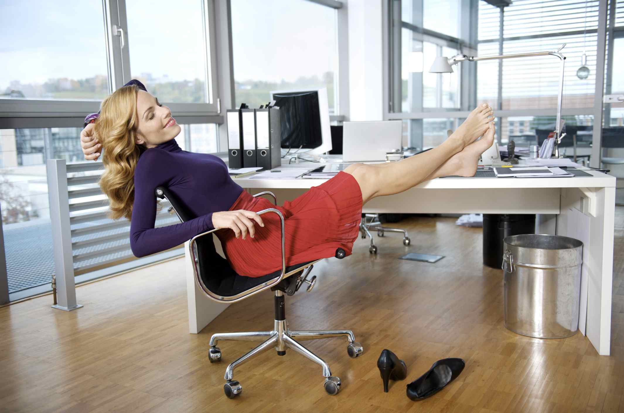 Woman with feet up on her desk