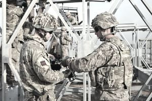 Soldiers from the 310th Multi-Role Bridge Company work alongside engineers from the British Army
