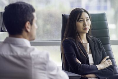 Businesswoman looking disappointed with folded arms.