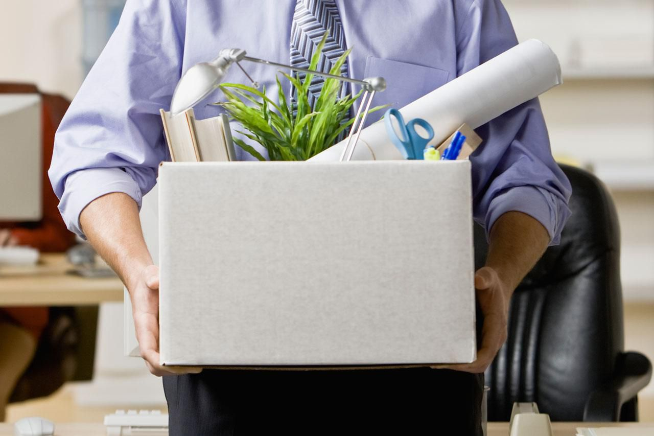 Man holding box with office supplies