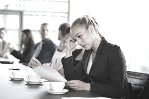 Businesswoman reading bad news at meeting