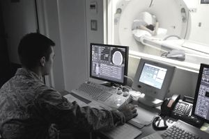 Senior Airman James Lord starts a CT scan Aug. 27, 2013, at Misawa Air Base, Japan. With this monitor, technologists can start and control a scan without being in the same room as the patient or machine. Lord is a 35th Surgical Operations Squadron diagnostic imaging technologist.