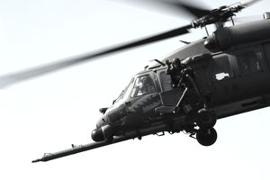 An aerial gunner waves from a HH-60 Pave Hawk.