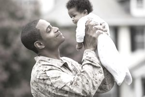 American military father holding baby
