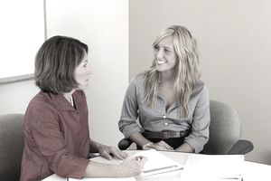 Two women talking in a business environment