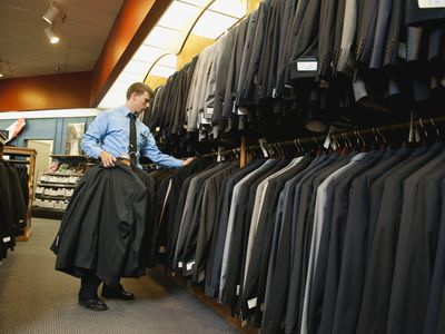Man shopping for suit in department store