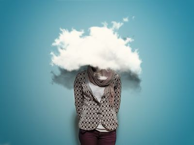 a photo illustration of a woman with her head in the clouds