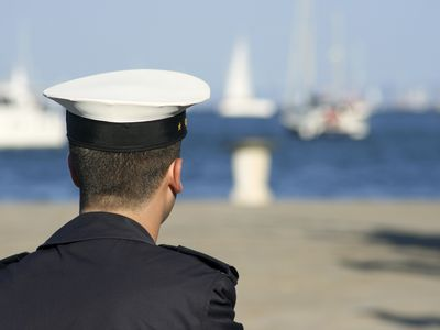 Young sailor in the harbor