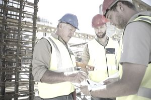 Three men working in an industrial setting