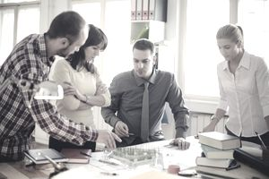Group of architects discussing in an office