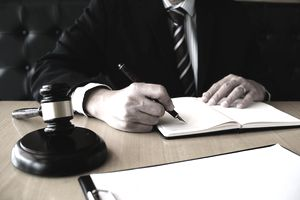 Legal writer preparing notes for an attorney