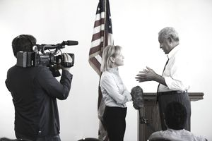 A politician being interviewed by a reporter