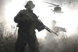 Marine corps field artillery soldier holding firearm in the field with a helicopter flying overhead