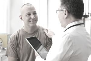 Male soldier and military doctor discussing his healthcare