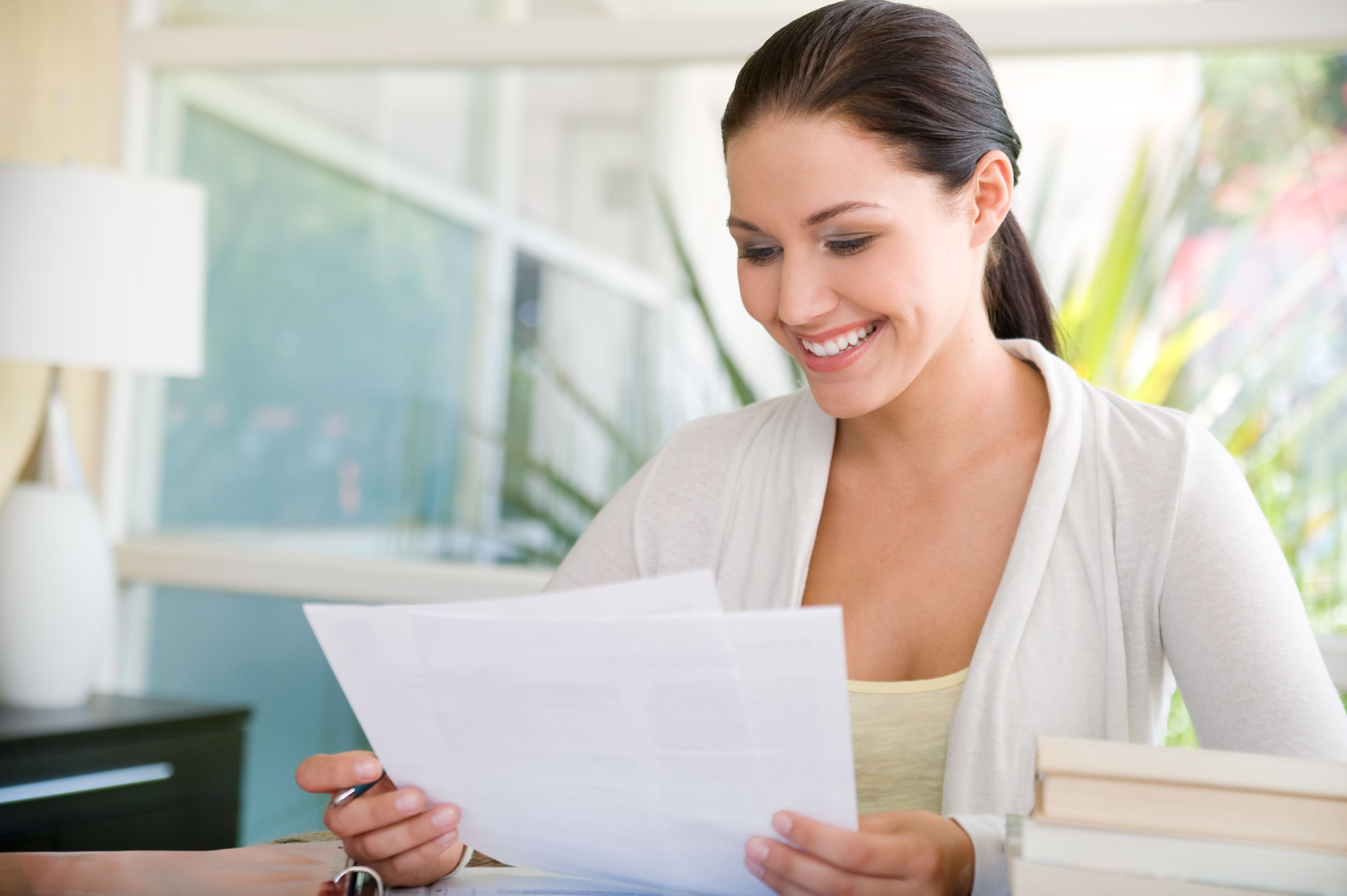 Image result for happy looking at paper
