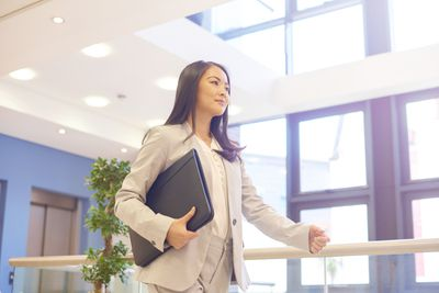 Woman going to interview with portfolio