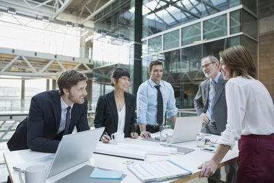Business people meeting around conference room table